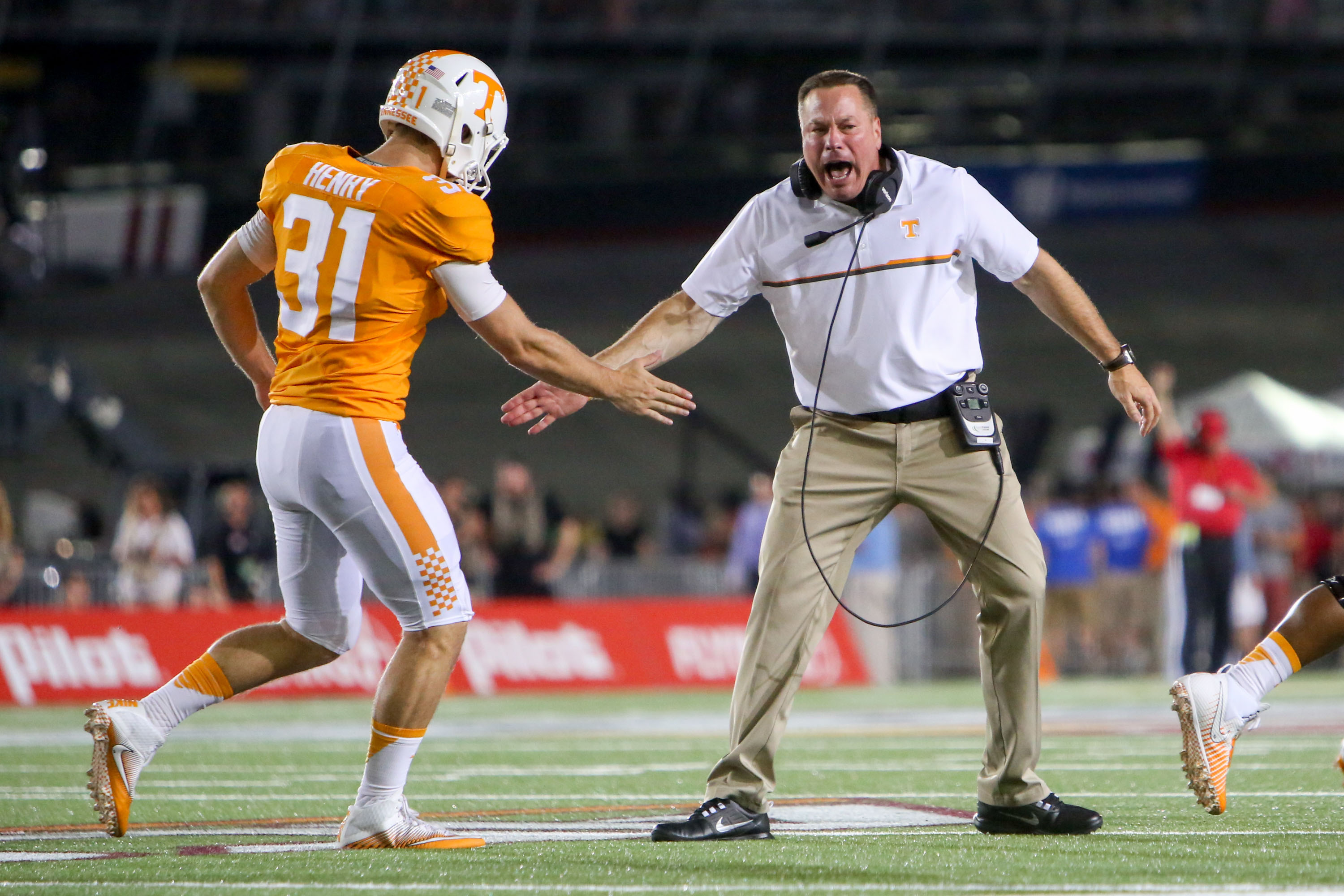Tennessee vols all fulmer all dooley and all jones teams sep 10 2016 bristol tn usa tennessee volunteers head coach butch jones congratulates tennessee volunteers running back parker henry 31 during the publicscrutiny Gallery